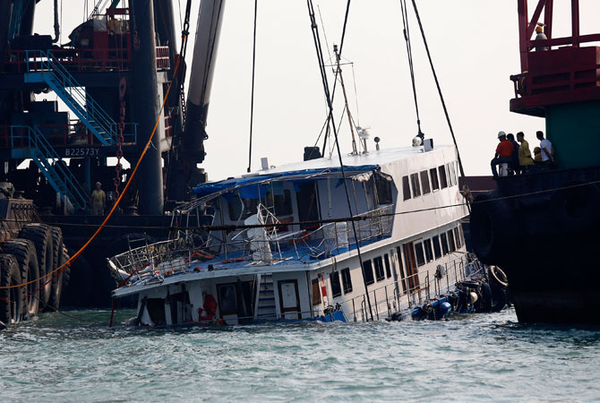 A half submerged boat is lifted by cranes Tuesday Oct. 2, 2012 after Monday night's collision near Lamma Island, off the southwestern coast of Hong Kong Island. ? Photo by AP