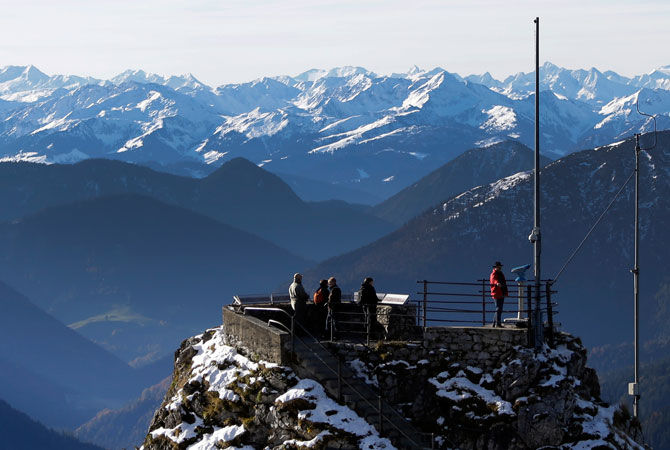 Hikers enjoy the view over the Alps from a viewing platform near the top of Wendelstein mountain. ? Photo by AP
