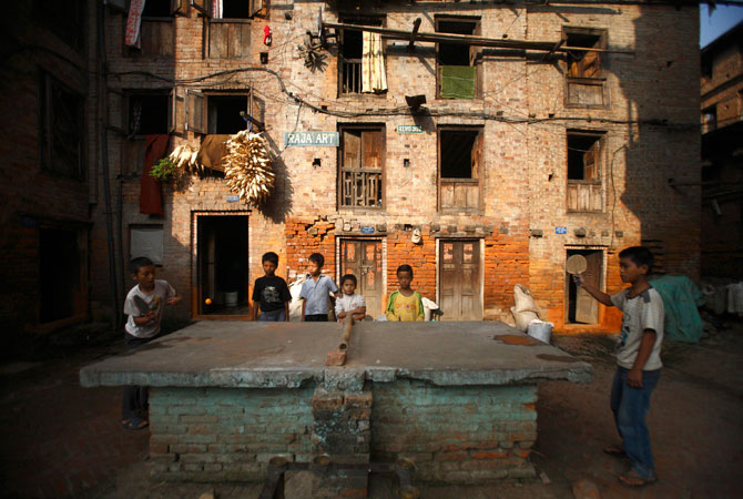 Children play ping pong at the ancient Nepalese city of Bhaktapur.