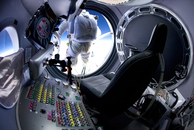 In this March 15, 2012, photo provided by Red Bull Stratos, pilot Felix Baumgartner of Austria prepares to jump at the first manned test flight for Red Bull Stratos in Roswell, N.M.  On Tuesday, Oct. 9, 2012, if winds allow, in the desert surrounding Roswell, Baumgartner will attempt to break Kittinger's world record for the highest and fastest free fall. ? Photo by AP