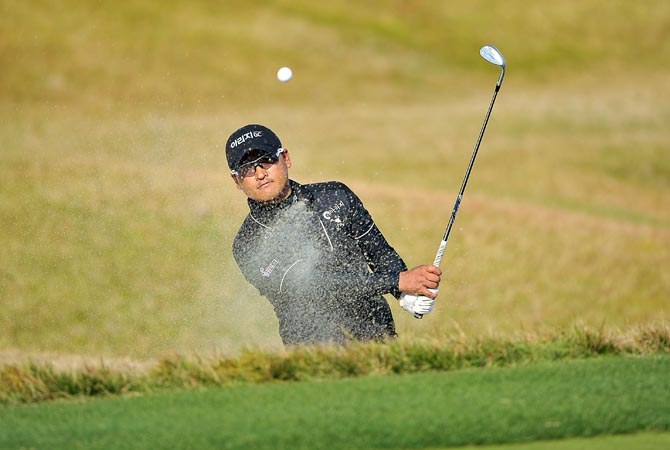 This handout photo released and taken by OneAsia shows Kim Dae-sub of South Korea hitting a shot before his victory on the final day of OneAsia's Kolon Korea Open at the Woo Jeong Hills Country Club in Cheonan, south of Seoul.  ?AFP Photo
