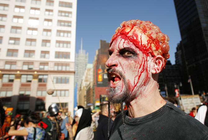 People dressed up as zombies walk on the street during an event in New York. ? Reuters Photo