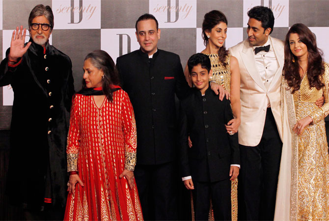 Bollywood star Amitabh Bachchan, left, gestures as he poses for photographs along with family members, wife Jaya Bachchan, second left, son-in-law Nikhil Nanda, third left, daughter Shweta Nanda, third right, son Abhishek Bachchan, second right, and daughter-in-law Aishwarya Rai-Bachchan during a party on the eve of his 70th birthday in Mumbai, India, Wednesday. ? Photo by AP