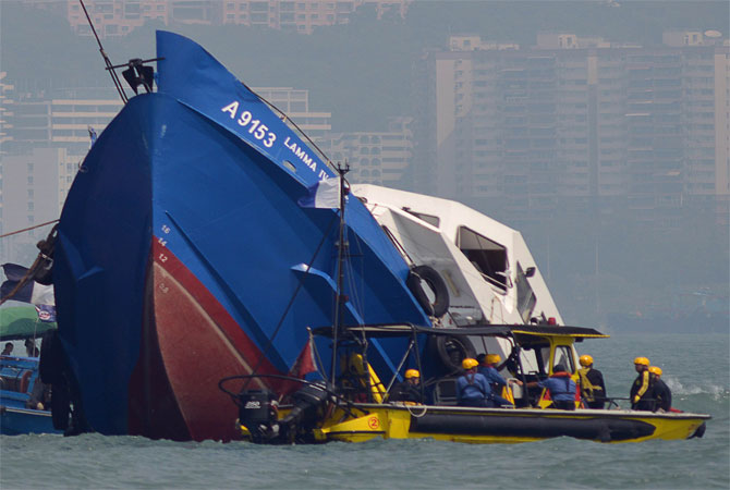The bow of the Lamma IV boat (Left) is seen partially submerged during rescue operations on October 2, 2012 the morning after it collided with a Hong Kong ferry. ? Photo by AFP