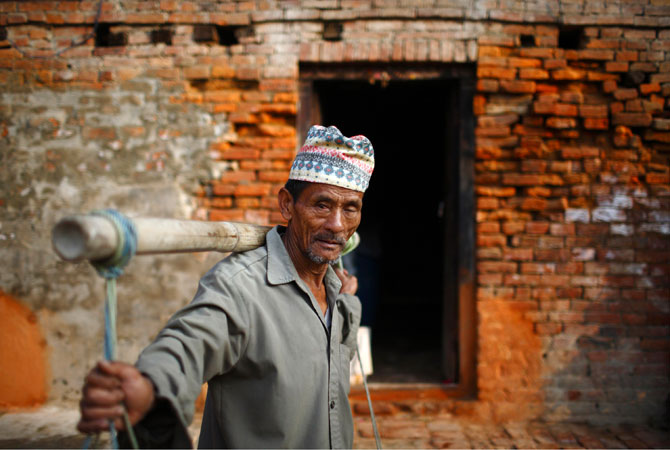 A farmer heads home after selling vegetables along the streets of the ancient Nepalese city of Bhaktapur.