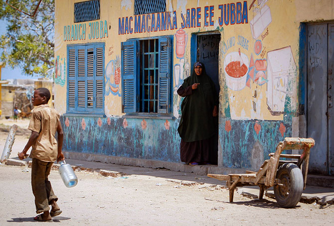 A Somali woman looks out from the doorway of a shop in a market area in the centre of the southern Somali port city of Kismayo, approx. 500km south of the country's capital Mogadishu