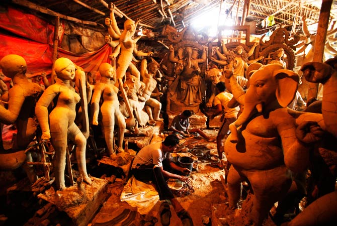 Artisans work on idols of Hindu Goddess Durga and other Hindu Gods at a workshop. ? Photo by AP