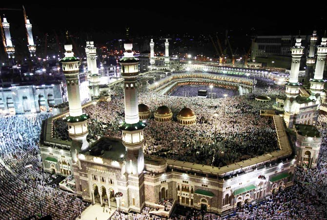 Pilgrims circle the Kaaba and pray at the Grand mosque. ? Photo by Reuters