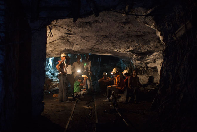 Miners rest inside an underground Barora coal mine at Dhanbad district in the eastern Indian state of Jharkhand.