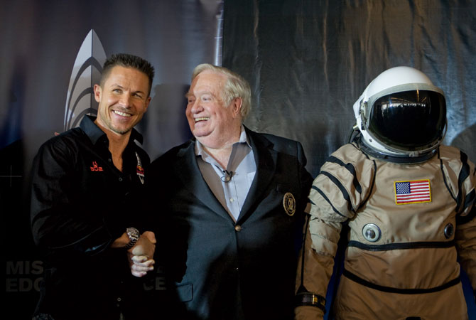In this Friday Jan. 22, 2010 photo provided by Red Bull Stratos, Pilot Felix Baumgartner, left, shakes hands with United States Air Force Col. (Ret.) Joe Kittinger, right, following the Red Bull Stratos press conference in New York announcing Baumgartner's plan to attempt to become the first person ever to break the speed of sound with the human body. ? Photo by AP
