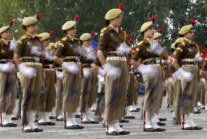 A female Indian police contingent performs a salute to Chief Minister of Kashmir Omar Abdullah (not seen) during a ceremony on Police Commemoration Day in Zewan, in the outskirts of Srinagar. Every year on October 21, Police Commemoration Day is observed to remember and pay respects to police personnel who were killed in the past year while performing different kinds of duties, a police media release said. ?Reuters Photo