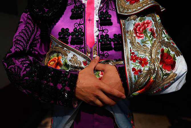 Mexican Novillero (aspiring bullfighter) Mirafuentes de Anda, 20, is seen before the start of a bullfight at La Mexico bullring in Mexico City September 16, 2012.