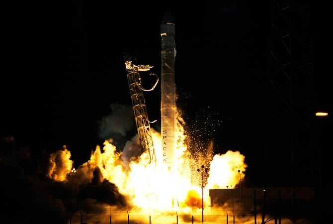 Space Launch Complex 40 is illuminated by a Falcon 9 rocket as it lifts. – Photo by Reuters