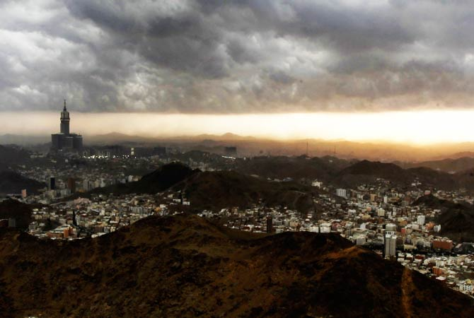 The sun sets over the holy city of Mecca as seen from the top of Mount Noor. ? Photo by Reuters