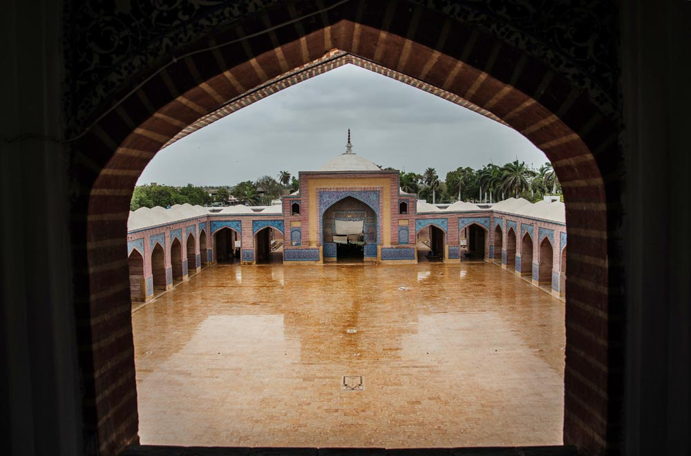 A view from the opposite side. This mosque has 93 domes and 33 arches with varying sizes. A piece of local folklore suggests that the domes are charmed in such a way that whoever tries to count them always gets confused and comes up with different results. - Photo by Sara Faruqi/Dawn.com