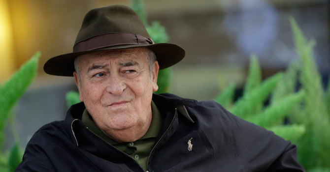 Wheelchair-bound Bertolucci says filming is 'like therapy'