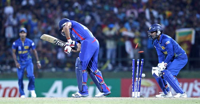 Ravi Bopara  is bowled by Jeevan Mendis  ? Photo by Reuters