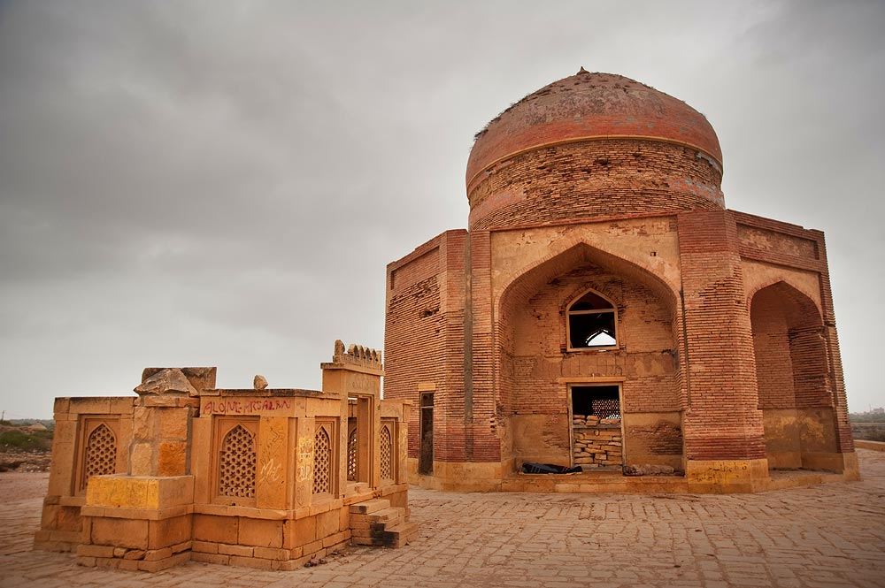 A view of two kinds of tomb built during the Tarkhan era. One [left] is made of the familiar stone but the other is the brick tomb of Sultan Ibrahim, the son of Isa Khan I (and brother of Isa Khan II whose tomb is pictured earlier). Ibrahim died in 1550.  - Photo by Nadir Siddiqi/Dawn.com