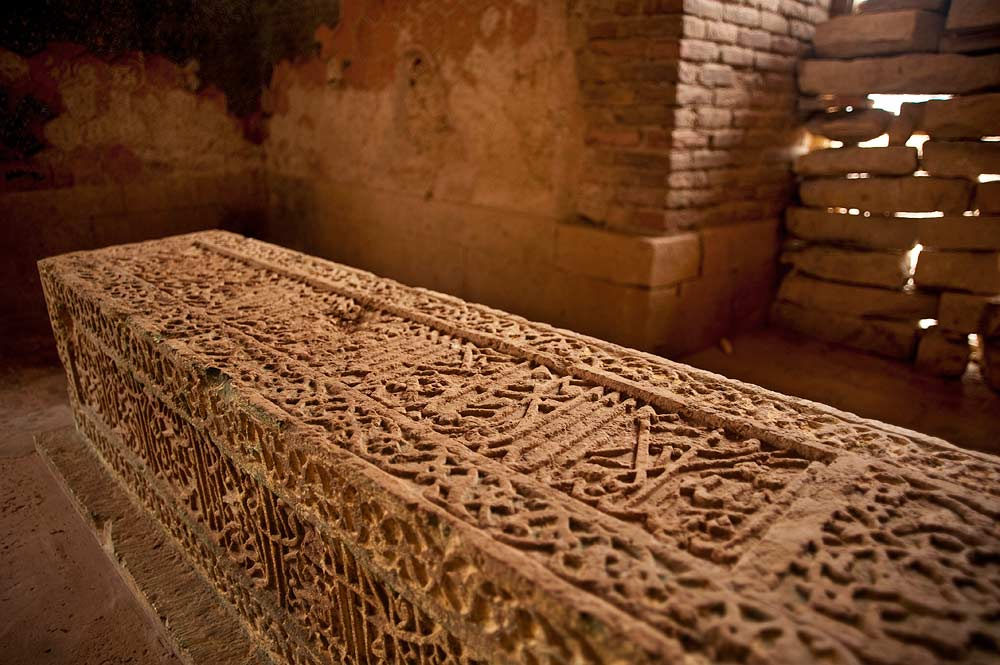 Inside the tomb, the grave is decorated with complex Quranic calligraphy. In Makli, Arabic scripts like Naskh and Nastaleeq were inscribed on stone graves in an expression of faith. - Photo by Nadir Siddiqi/Dawn.com