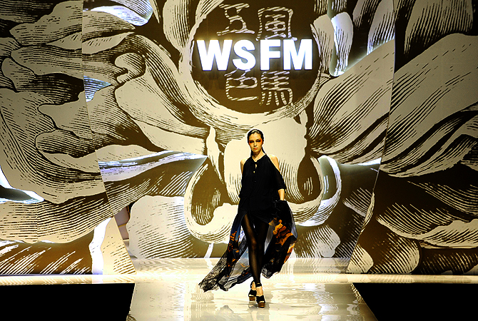 This picture shows a model showcasing a creation from a Chinese designer during the W.S.F.M Weilai Collection during the China Fashion Week in Beijing.?Photo by AFP