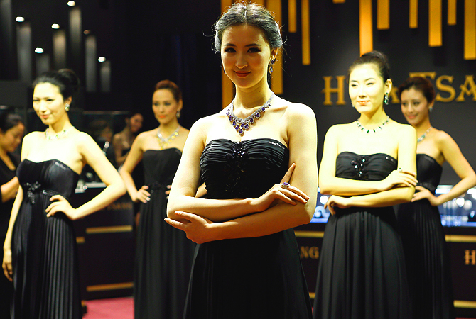 In this picture models pose with luxury jewellery at the Top Marques luxury exhibition in Shanghai. China is set to become the world's second biggest market for luxury goods after the United States in five years, overtaking France, Britain, Italy and Japan.?Photo by AFP