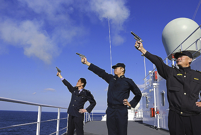 In this photo Chinese navy and civilian maritime personnel mark the start of exercises in Zhoushan in east China's Zhejiang province.?Photo by AFP