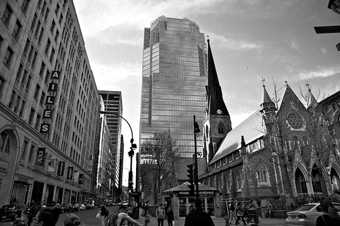 Buildings from three different periods coexist well in Montreal downtown. The church to the right is from the 19th century, the building to the left is from the early 20th century and the glass tower in the middle is a late 20th century high-rise office.
