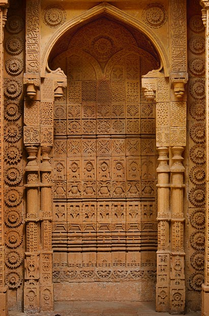 A view of a classical triple-mehrab on the tomb's western wall. The tomb architecture has  borrowed decorative motifs from the Hindu art of temple building, especially from Jainism, but also combines these with Islamic ones like the Meharab and the carving of Quranic verses using different motifs. - Photo by Sara Faruqi/Dawn.com