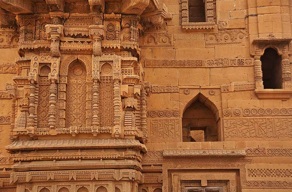 A partial view of the front ornamented wall of the tomb. Here too we see the basic design derived from Jain temple art but it is modified with the Islamic mehrab. - Photo by Nadir Siddiqi/Dawn.com