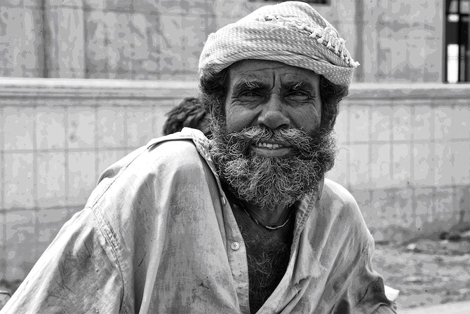 On one of my trips to Ibrahim Hyderi (a fishing village in Karachi) I noticed this man ? most likely a seasoned fisherman.  His handsome, battle hardened but yet gentle face startled me. Dress him up, take him to Buckingham palace and he is fit to be the King of England!  But why subject him to that old grouch the Queen? He is probably happy where he is.