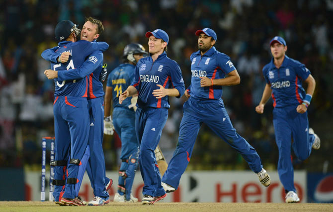 England's Graeme Swann (2nd L) embraces teammate Jonny Bairstow (left) after dismissing Sri Lanka's Kumar Sangakkara during the Twenty20 World Cup Super 8 cricket match in Pallekele October 1. - Photo by Reuters