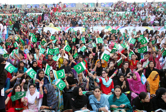 Patriotic emotions ran through the sky when around 70,000 participants of the Punjab Youth Festival joined voices to break the world record for the most people singing a National Anthem simultaneously at National Hockey Stadium. - Photo by INP