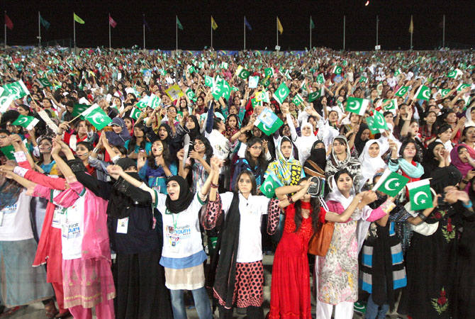 Patriotic emotions ran through the sky when around 70,000 participants of the Punjab Youth Festival joined voices with an aim to break the world record for the most people singing a National Anthem simultaneously at National Hockey Stadium. - Photo by INP