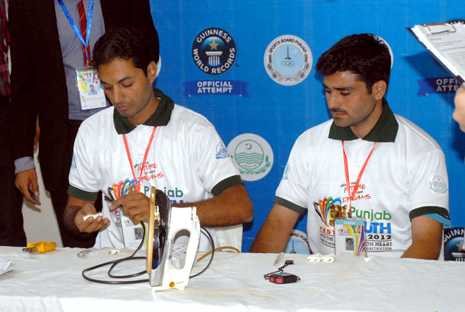 Noman Anjum set the new world record in plug wiring at the Punjab Youth Festival. - Photo by INP