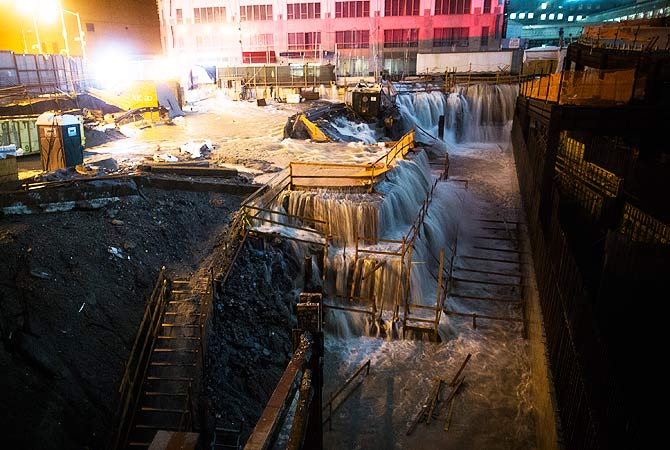 Sea water floods the Ground Zero construction site, in New York. Sandy continued on its path, as the storm forced the shutdown of mass transit, schools and financial markets, sending coastal residents fleeing, and threatening a dangerous mix of high winds and soaking rain.-Photo by AP