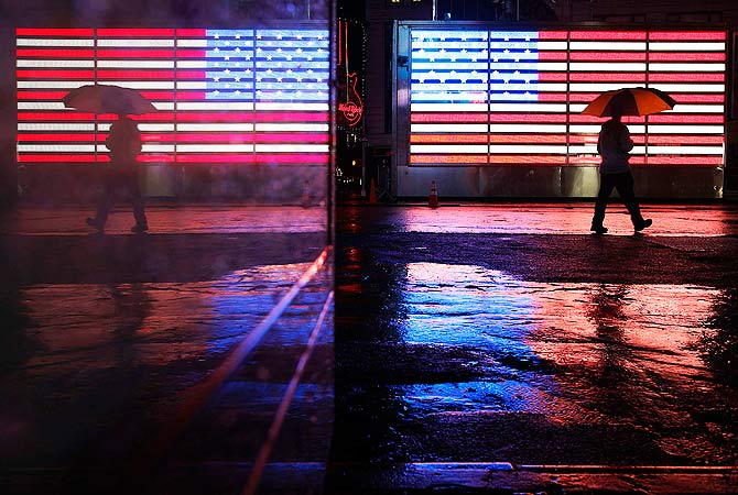 A man walks through a mostly deserted Times Square ahead of Hurricane Sandy in New York.-Photo by Reuters
