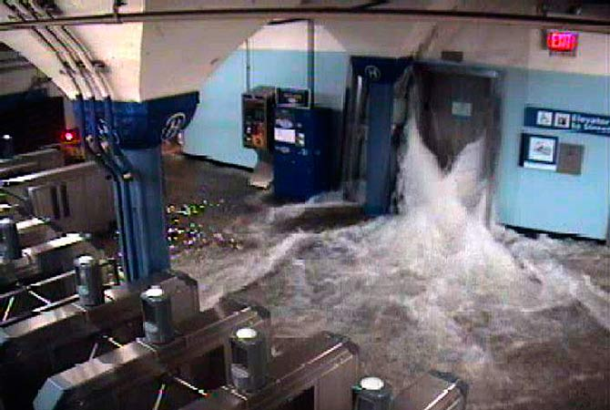 Floodwaters from Hurricane Sandy rush into the Port Authority Trans-Hudson's (PATH) Hoboken, New Jersey station through an elevator shaft in this video frame grab from the NY/NJ Port Authority twitter feed.-Photo by Reuters