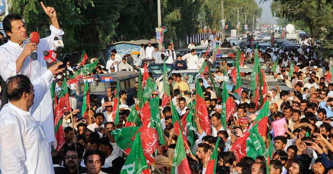 "Imran Khan addresses the ""Peace March"" convoy on its stopover in Mianwali – Photo by Reuters"