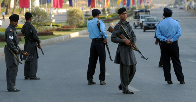 Policemen stand guard on a main road in Islamabad – AFP (File Photo)