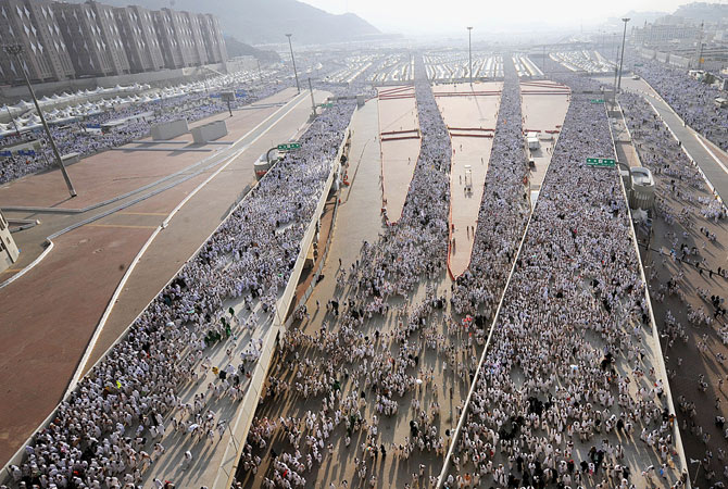 Thousands of Muslim pilgrims arrive to throw pebbles at pillars during the ?Jamarat? ritual, the stoning of Satan, in Mina near the holy city of Mecca, on October  26, 2012.