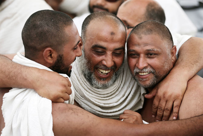 Muslim pilgrims hug each other as they celebrate after the ?Jamarat? ritual.