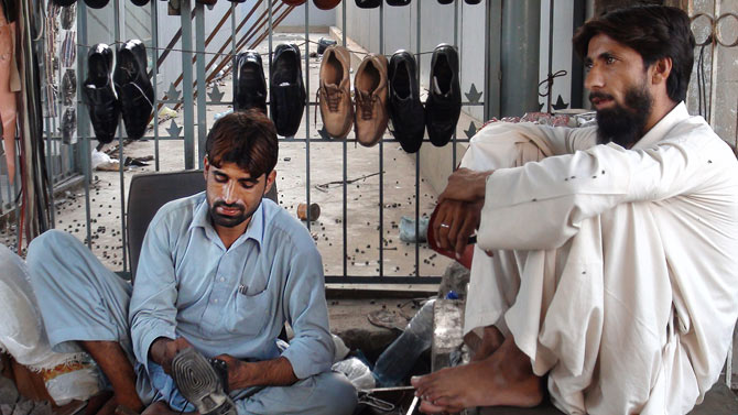 """Zubair Khan, a cobbler says """"The government should work harder against Talibanisation. No country can progress without education because it is essential to progress. Attacking students is an extremely condemnable act."""""""