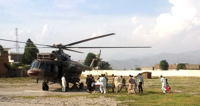 Malala Yousufzai, is moved to a helicopter . – Photo by AP