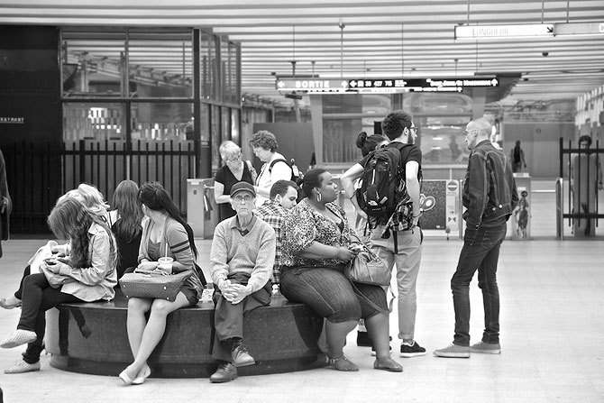 A typical eclectic cast of characters at a metro station, each engrossed in his and her own world!