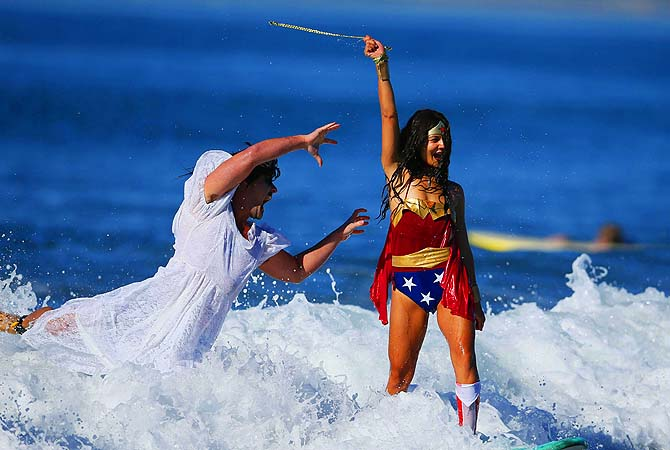 Wonder Woman and a dead bride, compete during the ZJ Boarding House Halloween surf contest in Santa Monica.?Photo by Reuters