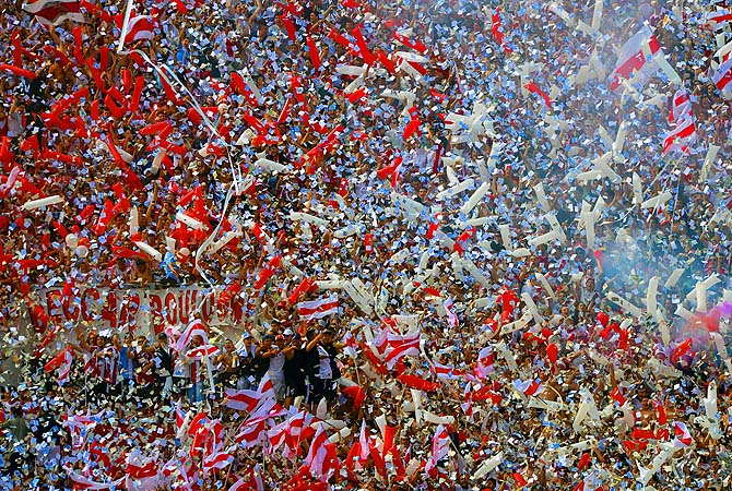 River Plate supporters cheer for their team before the start of their Argentine First Division football match against Boca Juniors at the Monumental stadium in Buenos Aires, Argentina.?Photo by AFP