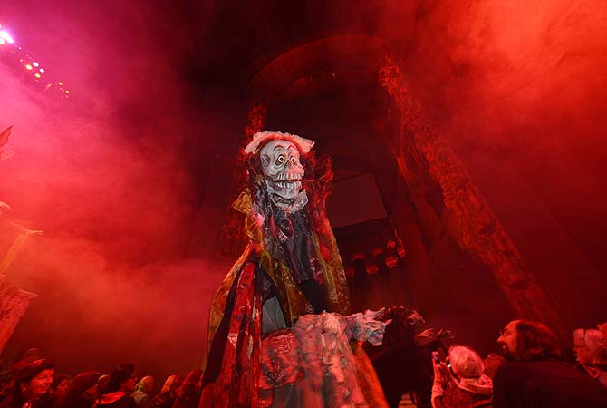 "A creature walks during ""The Grand Procession of the Ghouls"" at the Halloween Extravaganza and Procession of the Ghouls in New York. The annual Halloween theme night uses masks and costumes by director and artist Ralph Lee along with dry ice smoke, lighting and organ music.?Photo by AFP"