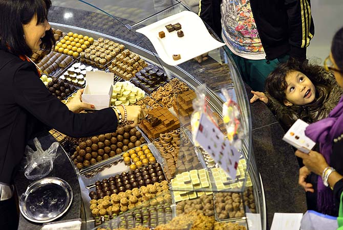 Visitors taste different sorts of chocolate, during the second International Salon des Chocolatiers et du Chocolat, Saturday, Oct.  27, 2012 in Geneva, Switzerland.?Photo by AP