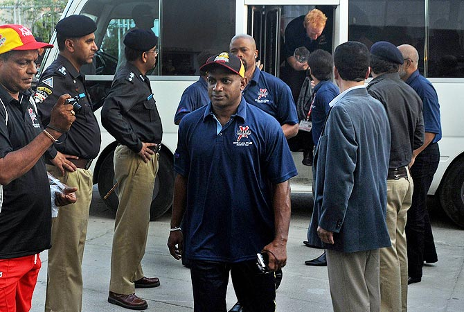 International World XI captain Sanath Jayasuriya (C) arrives at the stadium in Karachi. -Photo by AFP