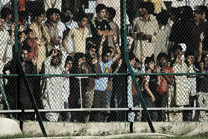 Fans watch the match between International World XI and Pakistan All Stars. -Photo by AFP